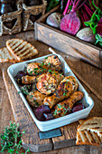 Roast chicken legs with beetroot and thyme