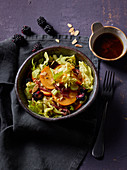 Green salad with persimmon and smoked duck breast
