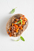 A baked potato with pumpkin, sausage meat, sage and cinnamon