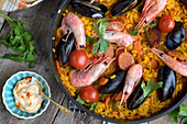 Harissa paella with merguez and seafood