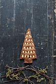 Gingerbread Christmas tree biscuits decorated with pine nuts