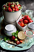 Ingredients and utensils for strawberry marmalade with kiwi