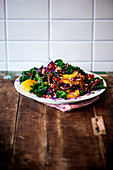 A winter salad with oranges, kale and red cabbage
