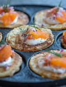 Blinis with Västerbotten cheese, prawns and caviar