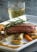 Duck breast with root vegetables, apples and cider gravy