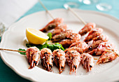 Prawn skewers on a plate