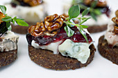 Pumpernickel topped with blue cheese, honey, walnuts and blackberries