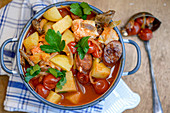 Fish stew with chorizo and mushrooms