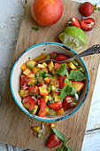 Peach salsa with strawberries and mint