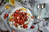 Pavlova with rhubarb, strawberries and pistachios