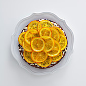 Egg-free chocolate cake with honey, almonds and oranges