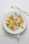Oven-baked plaice fillets with fennel and orange fillets