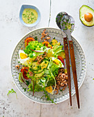 Garden salad with avocado, egg and shrimps