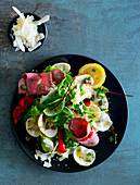 Salad with roast beef and Parmesan