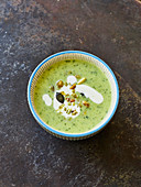 Cream of courgette soup with caramelised nuts