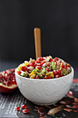 Oriental couscous salad with peppers and pomegranate seeds