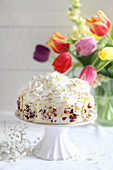 Festive spring cake with white chocolate and edible flowers