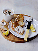 Smoked Mackerel pate with riccota on toast garnished with capers served with lemon wedges gar