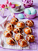 Easter breakfast hot cross buns with blue eggs