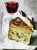 Slice of British Classic Stilton Blue Cheese with a glass of port