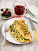 Pea vegetable and herb omelette with grape juice