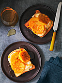 Persimmon and Goat's Cheese on toast with honey
