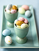 Baby easter eggs in egg cups
