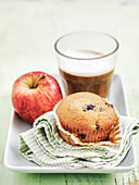 Blueberry muffin with apple and latte coffee
