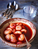 Peaches poached in rose wine
