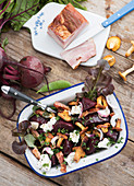 Autumnal beetroot salad with chanterelle mushrooms, bacon and feta cheese