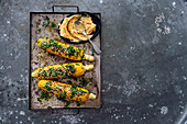 Corn cobs with herbs, sesame seeds and chilli served with mango butter