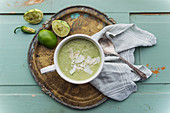 Cold avocado soup with cucumber, pepper and coconut
