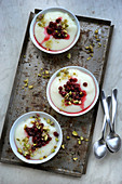 Ashta (Arabian pudding) with lingo berries and pistachio nuts