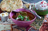 Rogan josh (Indian lamb dish) with garlic bread and rice