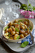 Roast potatoes with sage butter and olive oil
