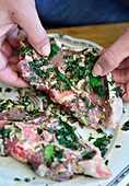 Marinated lamb chops with mint, lemon zest, garlic, salt, pepper and olive oil