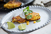 Sweetcorn and chilli fritters with Parmesan cheese and a dollop of sour cream