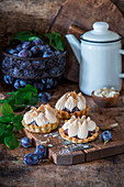 Plum meringue pies
