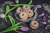 Mini Bundt cakes with marzipan and icing sugar
