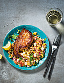 Harissa pork chops with apple couscous