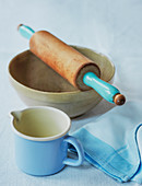 Bowl with rolling pin and measuring jug for pastry