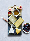 Various cheeses with figs and berries