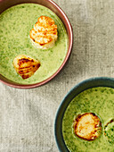 Spinach and lime soup with grilled scallops