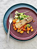 Grilled wild salmon with papaya chutney and herb salad