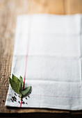 Peppercorns and bay leaves on a white tea towel