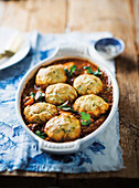 Chakalaka chicken neck stew with dumplings