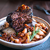Slow cooked beef short rib with butterbean stew and caramelised onions