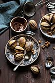 Walnut shaped cookies with chocolate walnut and rum ganache