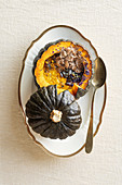 Pumpkin and chestnut risotto baked in a pumpkin with black truffles