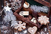 Christmas gingerbread cookies and chocolate candies in wooden gift box